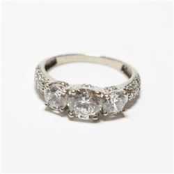 Lady's 10K White Gold Cubic Zirconia Trinity Ring - Size 7 1/4.  Total weight of 2.95 grams.
