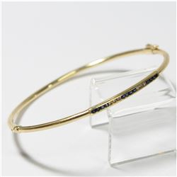 Lady's 10K Yellow Gold Diamond & Sapphire Bangle Bracelet with Safety Catch.  Total weight of 5.5 gr