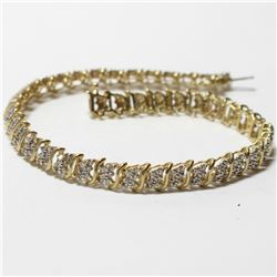 """Lady's 10K Yellow Gold Diamond Tennis Bracelet. Bracelet measures 8 1/2"""" Long with a total weight of"""