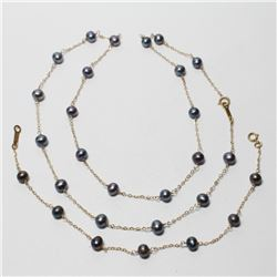 """Lady's 10K Yellow Gold Black Pearl Necklace & Bracelet Set. Necklace measures 20"""" in length, and the"""