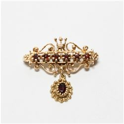 """Lady's Antique 14K Yellow Gold Garnet Brooch.  Length of the brooch measures just over 1"""" long by 1"""