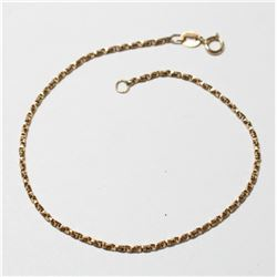 """10K Yellow Gold Twisted Box Chain Bracelet with Spring Ring Clasp. Measures 7 1/4"""" in length with a"""