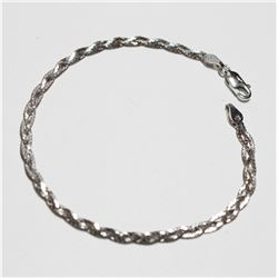 """Lady's 10K White Gold Braided Bracelet with Lobster Clasp. Measures 7 1/4"""" in length with a weight o"""