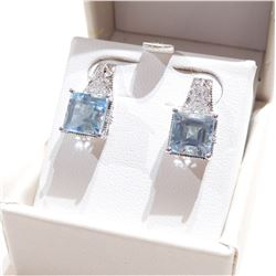 Lady's Sterling Silver Aqua Marine & Diamond Accented Earrings.  Post style earrings with butterfly