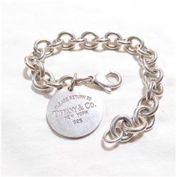 """Lady's Sterling Silver Bracelet Signed 'TIFFANY'.  Measures 7 1/4"""" in length."""
