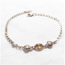 """Lady's 10K White & Rose Gold Bracelet - Measures 7 1/4"""" in length with a weight of 2.18 grams."""