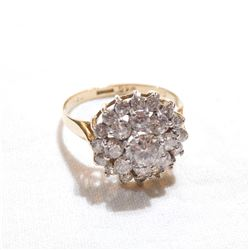 Lady's 10k Cubic Zirconia Cluster Style Ring - Size 7 3/4.  Total weight of 3.15 grams.