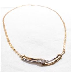 Lady's 10K Yellow & White Gold Diamond Necklace.  Length of 17.5 with a total weight of 5.32 grams.