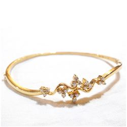 Lady's 18K Yellow Gold Diamond Hinged Cuff Bracelet. Total weight of 11.09 grams.
