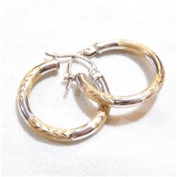 Lady's 14K White & Yellow Gold Hoop Earrings. Total weight of 1.11 grams.