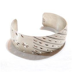Lady's Sterling Silver Etched Cuff Bracelet. Total weight of 21.82 grams.