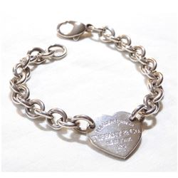 """Lady's Sterling Silver Bracelet Signed TIFFANY.  Measures 7.5"""" in length with a total weight of 26.6"""