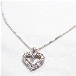 """Lady's 10K White Gold Diamond Heart Pendant on 14K White gold 18""""Chain.  Total weight of 3.88 grams."""