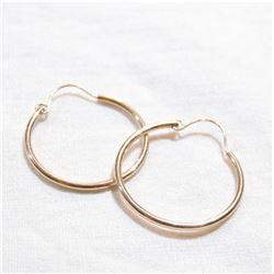Lady's 14K Yellow Gold Hoop earrings. Total weight of .87 grams.