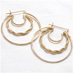 Lady's 14K Yellow Gold Post Style Hoop Earrings. Total weight of 4.63 grams.