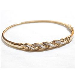 Lady's 10K Yellow Gold Baguette Diamond Inlayed Hinged Cuff Bracelet. Total weight of 8.4 grams.