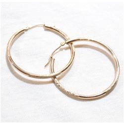 10K Yellow Gold Etched Hoop Earrings. Total weight of 1.23 grams.