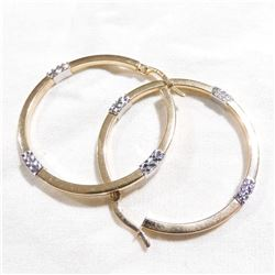 Lady's 14K Yellow & White Gold Accented Hoop Earrings. Total weight of 3.65 grams.