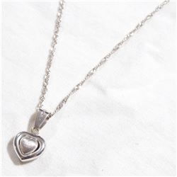"10K White Gold 3-Dimensional Heart Pendant on 18"" Chain. Total weight of 3.06 grams."