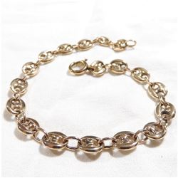 "Lady's 14K Yellow Gold Solid Gucci Link Bracelet.  Measures 7 3/4"" in length with a total weight of"