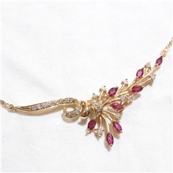 "Lady's 14K Yellow gold Diamond and Ruby Necklace. Measures approx.. 16.5"" in length with a total wei"