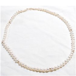 "Lady's 14K Yellow Gold Pearl Necklace with Gold Beads.  Measures 18"" in length."