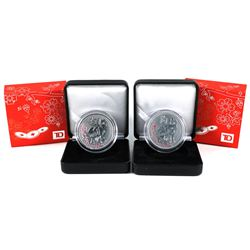 Pair of  TD  Canada trust  - Year of the Dog 1oz .999 fine silver rounds (Tax Exempt). Coins come en
