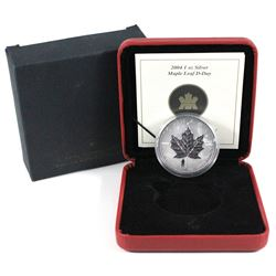 2004 Canada $5 D-day privy Mark silver maple leaf ( Tax Exempt). Coin is toned.