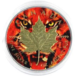 2018 Stalking Tiger Colourized & 24K Gold Plated $5 Silver Maple Leaf. Coin capsule is cracked. (Tax