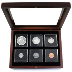 1961  Silver Proof-Like year set in mahogany finish display case.