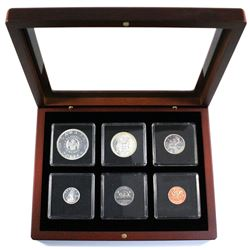 1964 Silver Proof-Like year set in mahogany finish display case.