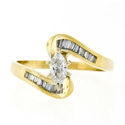 14kt Yellow Gold 0.70 ctw Marquise Diamond Solitaire Bypass Ring w/ Baguette Acc