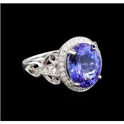 14KT White Gold 6.59 ctw Tanzanite and Diamond Ring