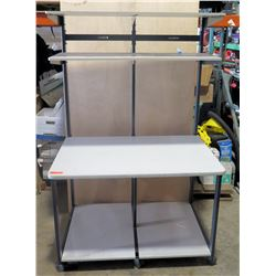 Large rolling table with shelves.