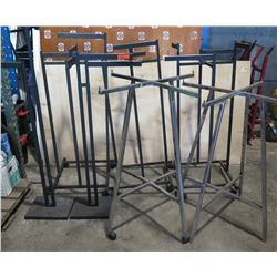 Mixed lot of clothes display racks.   As shown.   Some casters missing.   No ring for silver racks.