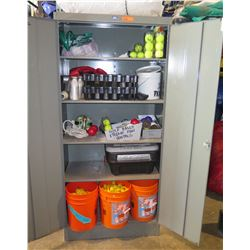 Metal Cabinet with all contents as pictured.   Misc items, carnival game parts, balls, cans, bottles