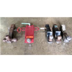 """Lot of Tow hitches 2"""" and 2 5/16"""".   The red hitch is actually for a forklift hitch but it is bent."""