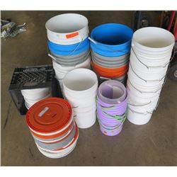 Qty 34 - Buckets.   Plastic 5 gal and 2 gal buckets.   Mixed tops.  Most tops have holes in them for