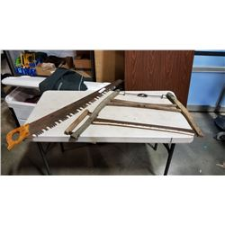 LARGE VINTAGE SAW AND WOOD BOW SAW
