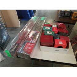 Lot of christmas ornaments on box with lights