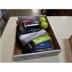 Box of new headbands, golf balls and tennis balls
