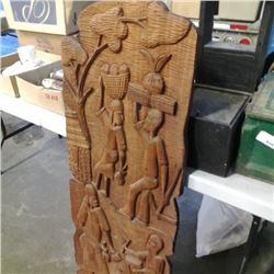 """47"""" highly carved slab of wood"""