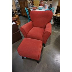RED UPHOLSTERED ARMCHAIR WITH OTTOMAN