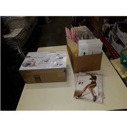 Box of new pantyhose, slippers and fitness ball