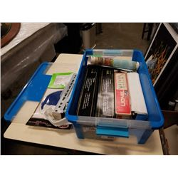 Tote of model train cars and wire