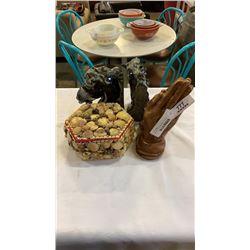 Lidded shell jar, prayer hands, and horse bookends