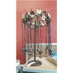 LEATHER NECKLACES ON SPINNING DISPLAY RACK
