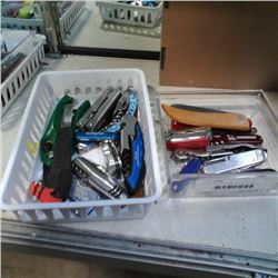 2 trays of pocket knives and multi tools