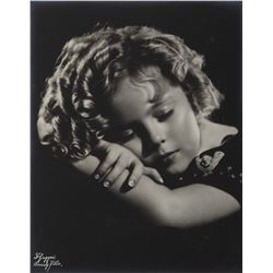 Collection of (4) Shirley Temple framed studio portraits.