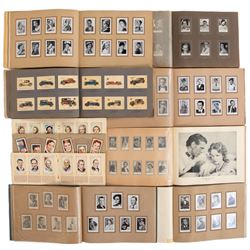 Large collection of (14) albums containing 100s of vintage cigarette cards.